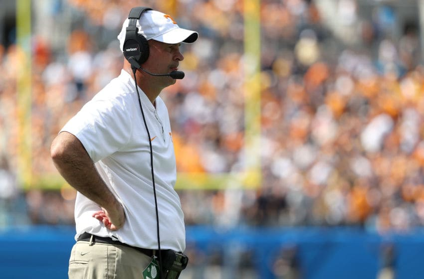 CHARLOTTE, NC - SEPTEMBER 01: Head coach Jeremy Pruitt of the Tennessee Volunteers watches on against the West Virginia Mountaineers during their game at Bank of America Stadium on September 1, 2018 in Charlotte, North Carolina. (Photo by Streeter Lecka/Getty Images)