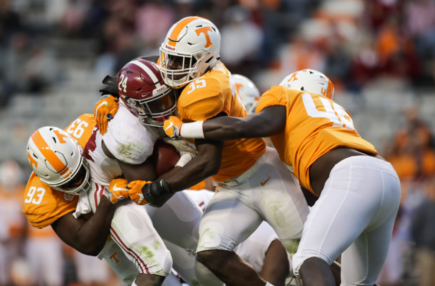 KNOXVILLE, TN - OCTOBER 20: Brian Robinson Jr. #24 of the Alabama Crimson Tide is tackled by Defensive lineman Emmit Gooden #93 of the Tennessee Volunteers, Linebacker Daniel Bituli #35 of the Tennessee Volunteers, and Linebacker Matt Ballard of the Tennessee Volunteers during the second half of the game between the Alabama Crimson Tide and the Tennessee Volunteers at Neyland Stadium on October 20, 2018 in Knoxville, Tennessee. (Photo by Donald Page/Getty Images)