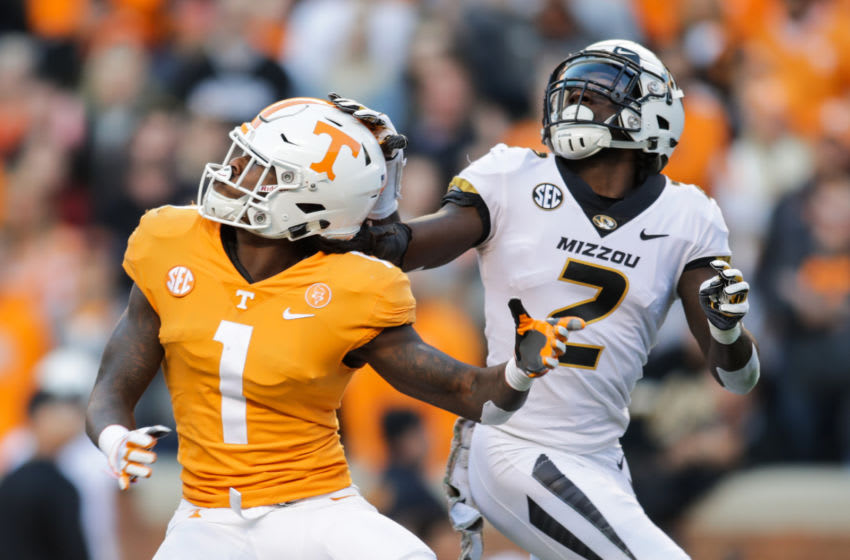KNOXVILLE, TN - NOVEMBER 17: Marquez Callaway #1 of the Tennessee Volunteers and DeMarkus Acy #2 of the Missouri Tigers compete for a pass during the first half of the game between the Missouri Tigers and the Tennessee Volunteers at Neyland Stadium on November 17, 2018 in Knoxville, Tennessee. (Photo by Donald Page/Getty Images)