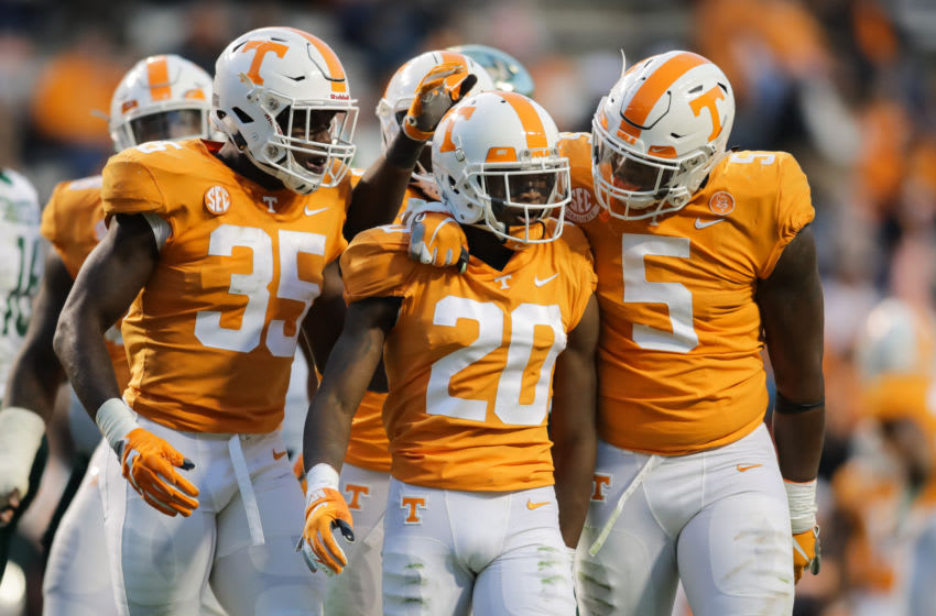 KNOXVILLE, TN - NOVEMBER 3: Linebacker Daniel Bituli #35 of the Tennessee Volunteers, Defensive back Bryce Thompson #20 of the Tennessee Volunteers, and Defensive lineman Kyle Phillips #5 of the Tennessee Volunteers react to a play during the game between the Charlotte 49ers and the Tennessee Volunteers at Neyland Stadium on November 3, 2018 in Knoxville, Tennessee. Tennessee won the game 14-3. (Photo by Donald Page/Getty Images)