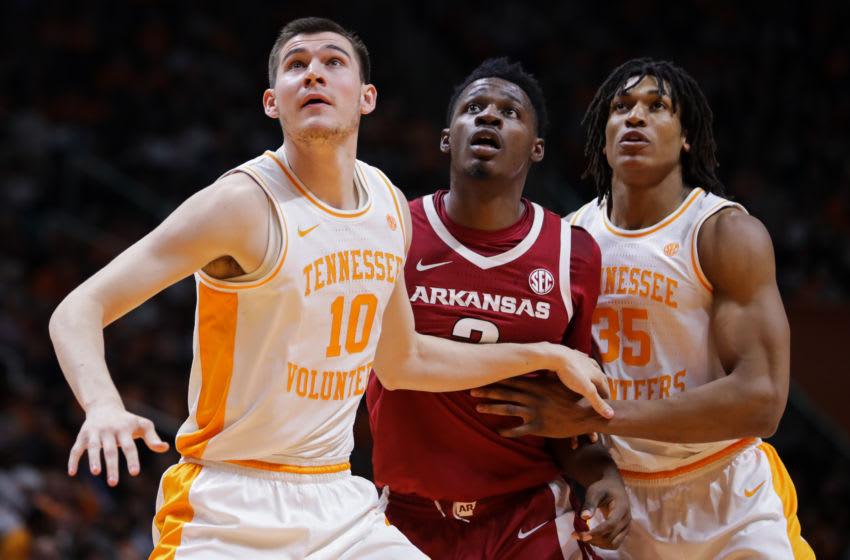 KNOXVILLE, TN - JANUARY 15: John Fulkerson #10 and Yves Pons #35 of the Tennessee Volunteers block out against Adrio Bailey #2 of the Arkansas Razorbacks during a game at Thompson-Boling Arena on January 15, 2019 in Knoxville, Tennessee. Tennessee won 106-87. (Photo by Donald Page/Getty Images)