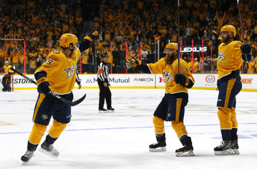 NASHVILLE, TENNESSEE - APRIL 10: Ryan Ellis #4 and Austin Watson #51 of the Nashville Predators react after a goal by teammate Roman Josi #59 against the Dallas Stars in Game One of the Western Conference First Round during the 2019 NHL Stanley Cup Playoffs at Bridgestone Arena on April 10, 2019 in Nashville, Tennessee. (Photo by Frederick Breedon/Getty Images)