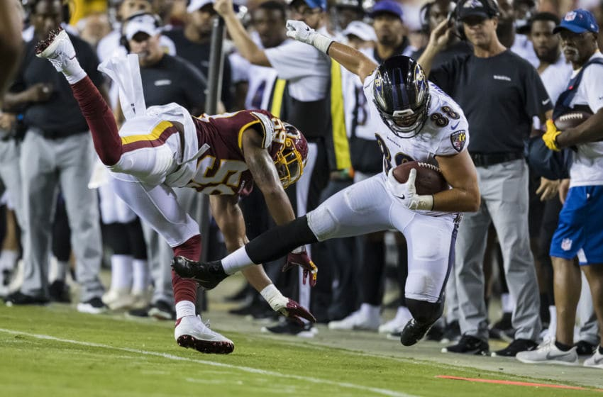 LANDOVER, MD - AUGUST 29: Darrell Williams #59 of the Washington Redskins hits Cole Herdman #88 of the Baltimore Ravens out of bounds during the second half of a preseason game at FedExField on August 29, 2019 in Landover, Maryland. (Photo by Scott Taetsch/Getty Images)