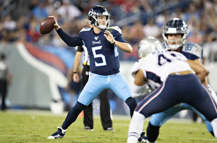NASHVILLE, TN - AUGUST 17: Logan Woodside #5 of the Tennessee Titans throws a pass during a game against the New England Patriots during week two of the preseason at Nissan Stadium on August 17, 2019 in Nashville, Tennessee. The Patriots defeated the Titans 22-17. (Photo by Wesley Hitt/Getty Images)