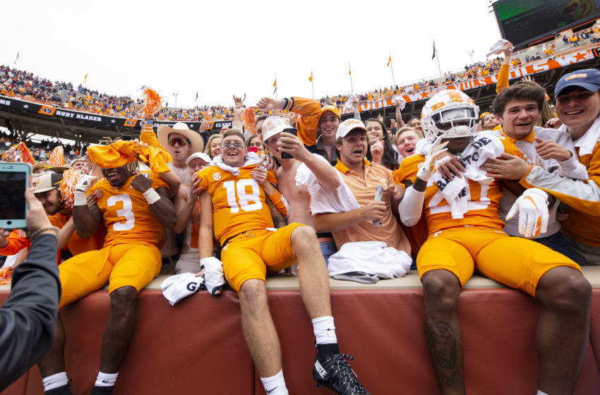 KNOXVILLE, TN - OCTOBER 12: Eric Gray #3, Brian Maurer #18, and Bryce Thompson #20 of the Tennessee Volunteers celebrate with fans after defeating the Mississippi State Bulldogs 20-10 at Neyland Stadium on October 12, 2019 in Knoxville, Tennessee. (Photo by Carmen Mandato/Getty Images)