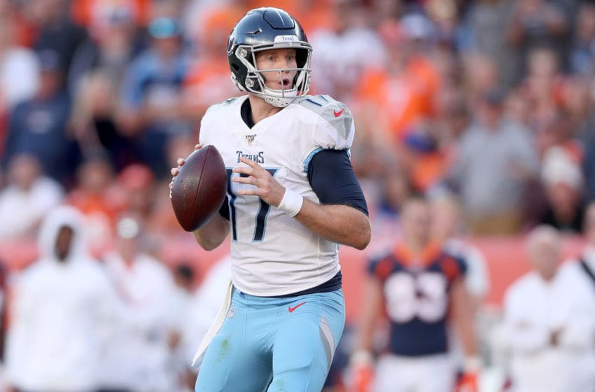 DENVER, COLORADO - OCTOBER 13: Quarterback Ryan Tannehill #17 of the Tennessee Titans throws against the Denver Broncos in the fourth quarter at Broncos Stadium at Mile High on October 13, 2019 in Denver, Colorado. (Photo by Matthew Stockman/Getty Images)