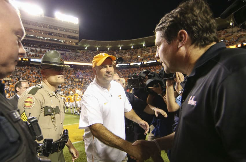 KNOXVILLE, TENNESSEE - OCTOBER 26: Head coach Jeremy Pruitt of the Tennessee Volunteers shakes hands with head coach Will Muschamp of the South Carolina Gamecocks after the game at Neyland Stadium on October 26, 2019 in Knoxville, Tennessee. (Photo by Silas Walker/Getty Images)