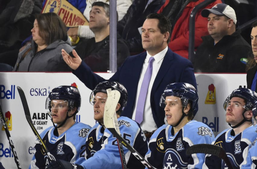 LAVAL, QC - NOVEMBER 15: Head coach of the Milwaukee Admirals Karl Taylor calls out instructions from the bench against the Laval Rocket during the third period at Place Bell on November 15, 2019 in Laval, Canada. The Milwaukee Admirals defeated the Laval Rocket 5-2. (Photo by Minas Panagiotakis/Getty Images)