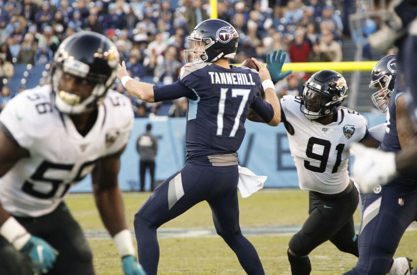 NASHVILLE, TENNESSEE - NOVEMBER 24: Yannick Ngakoue #91 of the Jacksonville Jaguars knocks the ball out of the hand of quarterback Ryan Tannehill #17 of the Tennessee Titans during the first half at Nissan Stadium on November 24, 2019 in Nashville, Tennessee. (Photo by Frederick Breedon/Getty Images)