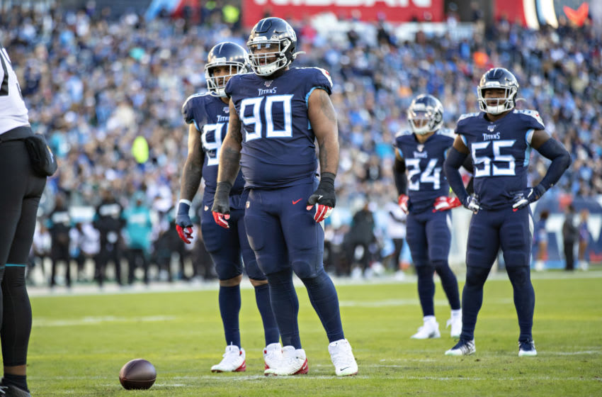 NASHVILLE, TN - NOVEMBER 24: DaQuan Jones #90 of the Tennessee Titans at the line of scrimmage during the first half of a game against the Jacksonville Jaguars at Nissan Stadium on November 24, 2019 in Nashville, Tennessee. The Titans defeated the Jaguars 42-20. (Photo by Wesley Hitt/Getty Images)