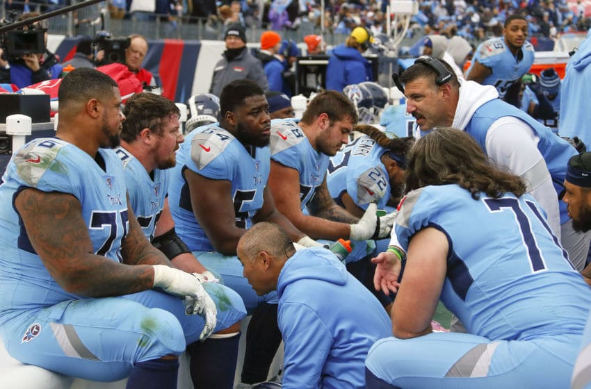 NASHVILLE, TENNESSEE - DECEMBER 15: Head coach Mike Vrabel of the Tennessee Titans speaks to his offensive line during the second half of a game against the Houston Texans at Nissan Stadium on December 15, 2019 in Nashville, Tennessee. (Photo by Frederick Breedon/Getty Images)