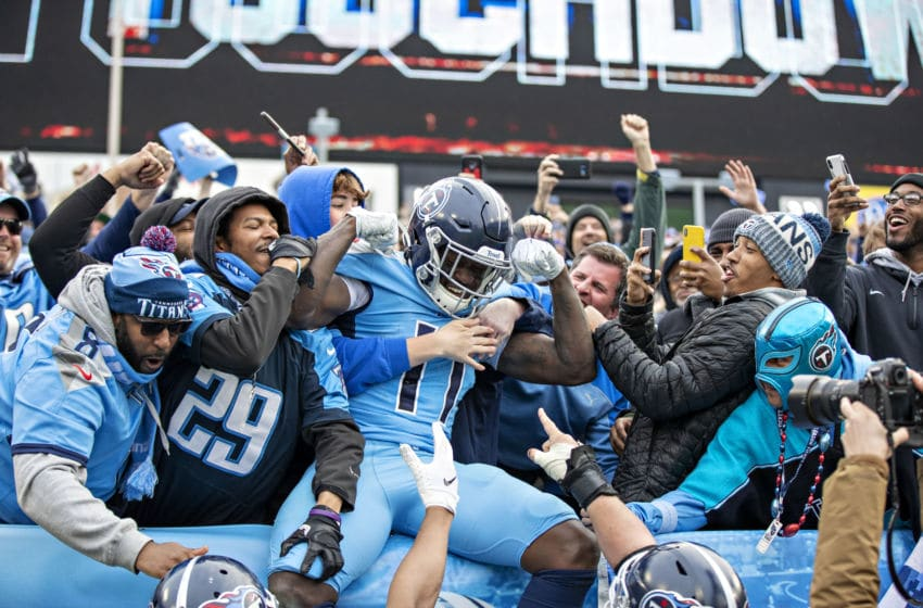NASHVILLE, TN - DECEMBER 15: A.J. Brown #11 of the Tennessee Titans celebrates with fans after catching a touchdown pass during a game against the Houston Texans at Nissan Stadium on December 15, 2019 in Nashville, Tennessee. The Texans defeated the Titans 24-21. (Photo by Wesley Hitt/Getty Images)