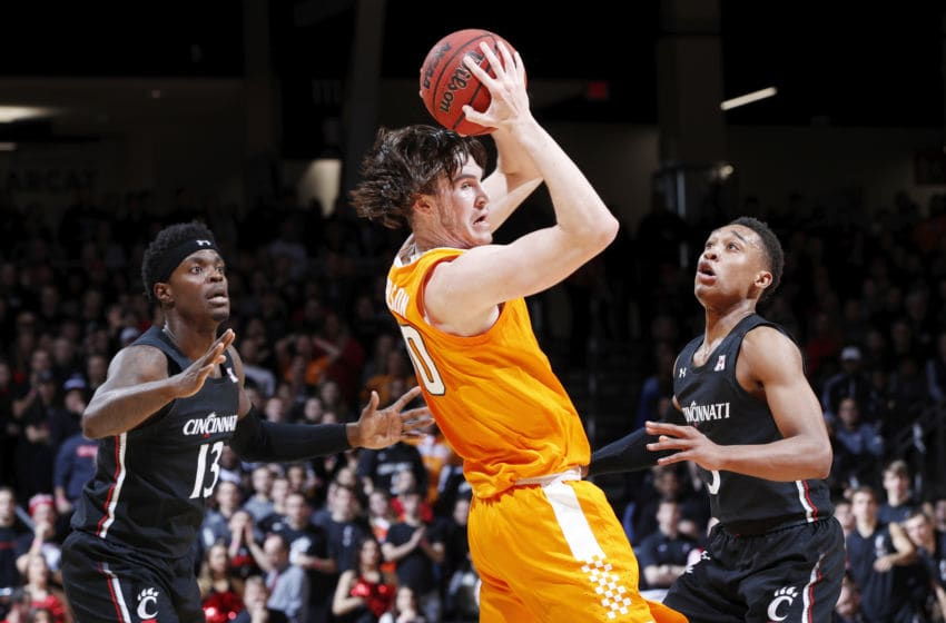 CINCINNATI, OH - DECEMBER 18: Mika Adams-Woods #3 and Tre Scott #13 of the Cincinnati Bearcats defend against John Fulkerson #10 of the Tennessee Volunteers in the first half of the game at Fifth Third Arena on December 18, 2019 in Cincinnati, Ohio. Cincinnati defeated Tennessee 78-66. (Photo by Joe Robbins/Getty Images)