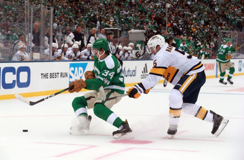 DALLAS, TEXAS - JANUARY 01: Denis Gurianov #34 of the Dallas Stars and Dan Hamhuis #5 of the Nashville Predators battle for the puck in the third period of the NHL Winter Classic at the Cotton Bowl on January 01, 2020 in Dallas, Texas. (Photo by Richard Rodriguez/Getty Images)