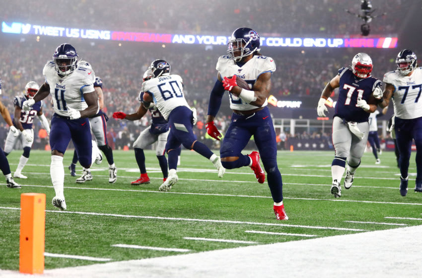 FOXBOROUGH, MASSACHUSETTS - JANUARY 04: Derrick Henry #22 of the Tennessee Titans carries the ball against the New England Patriots in the second quarter of the AFC Wild Card Playoff game at Gillette Stadium on January 04, 2020 in Foxborough, Massachusetts. (Photo by Adam Glanzman/Getty Images)
