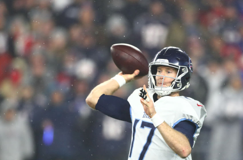 FOXBOROUGH, MASSACHUSETTS - JANUARY 04: Ryan Tannehill #17 of the Tennessee Titans throws a pass as they take on the New England Patriots in the second half of the AFC Wild Card Playoff game at Gillette Stadium on January 04, 2020 in Foxborough, Massachusetts. The Titans won 20-13. (Photo by Adam Glanzman/Getty Images)