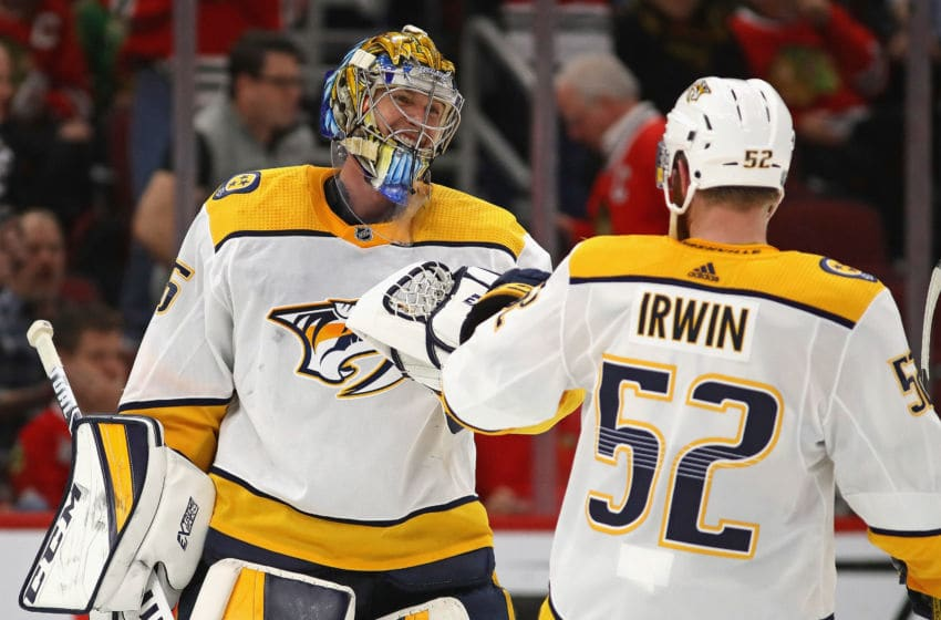 CHICAGO, ILLINOIS - JANUARY 09: Pekka Rinne #35 of the Nashville Predators celebrates a win against the Chicago Blackhawks and his first career goal, an empty net shot, with Matt Irwin #52 at the United Center on January 09, 2020 in Chicago, Illinois. The Predators defeated the Blackhawks 5-2. (Photo by Jonathan Daniel/Getty Images)