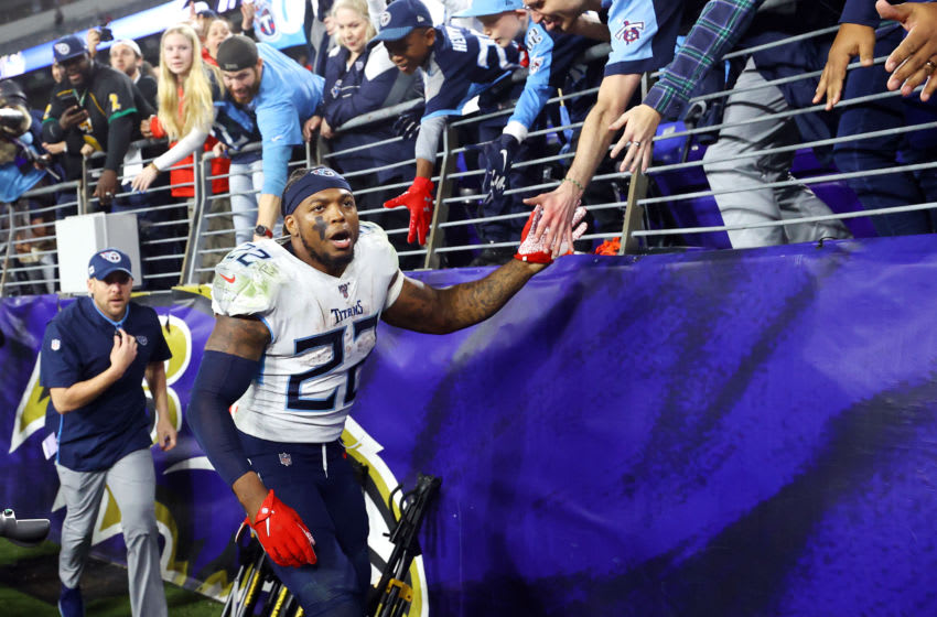 BALTIMORE, MARYLAND - JANUARY 11: Derrick Henry #22 of the Tennessee Titans celebrates with fans after winning the AFC Divisional Playoff game 28-12 over the Baltimore Ravens at M&T Bank Stadium on January 11, 2020 in Baltimore, Maryland. (Photo by Rob Carr/Getty Images)