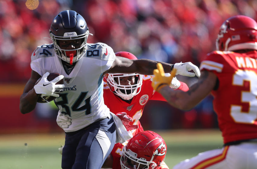 KANSAS CITY, MISSOURI - JANUARY 19: Corey Davis #84 of the Tennessee Titans runs with the ball in the first quarter against the Kansas City Chiefs in the AFC Championship Game at Arrowhead Stadium on January 19, 2020 in Kansas City, Missouri. (Photo by Matthew Stockman/Getty Images)