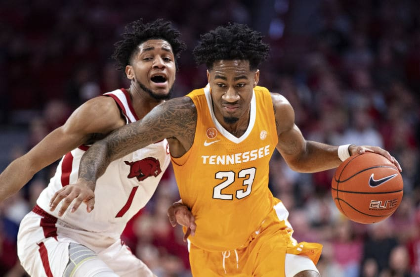 FAYETTEVILLE, AR - FEBRUARY 26: Jordan Bowden #23 of the Tennessee Volunteers drives to the basket in the first half against Isaiah Joe #1 of the Arkansas Razorbacks at Bud Walton Arena on February 26, 2020 in Fayetteville, Arkansas. (Photo by Wesley Hitt/Getty Images)
