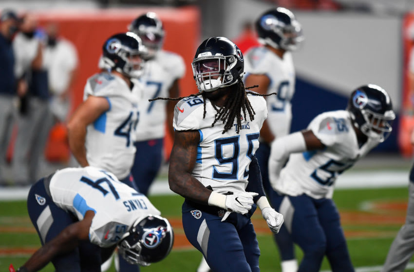 DENVER, CO - SEPTEMBER 14: Jadeveon Clowney #99 of the Tennessee Titans warms up before a game against the Denver Broncos at Empower Field at Mile High on September 14, 2020 in Denver, Colorado. (Photo by Dustin Bradford/Getty Images)