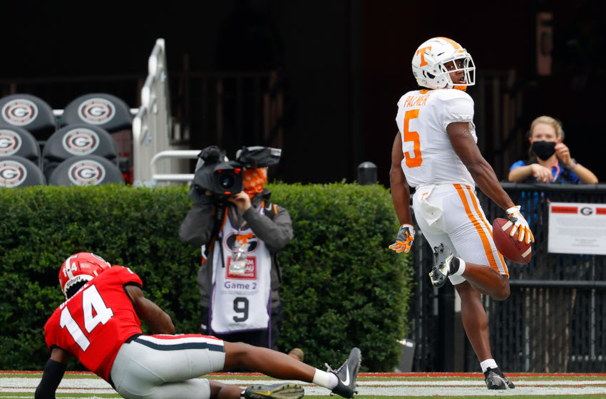 ATHENS, GEORGIA - OCTOBER 10: Josh Palmer #5 of the Tennessee Volunteers reacts after pulling in this touchdown reception against DJ Daniel #14 of the Georgia Bulldogs during the first half at Sanford Stadium on October 10, 2020 in Athens, Georgia. (Photo by Kevin C. Cox/Getty Images)