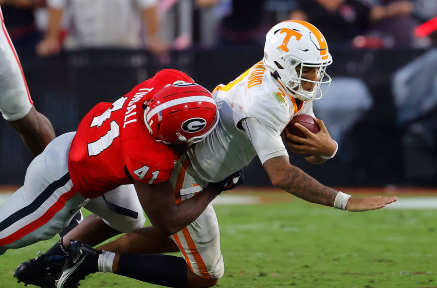 ATHENS, GEORGIA - OCTOBER 10: Channing Tindall #41 of the Georgia Bulldogs sacks Jarrett Guarantano #2 of the Tennessee Volunteers during the second half at Sanford Stadium on October 10, 2020 in Athens, Georgia. (Photo by Kevin C. Cox/Getty Images)