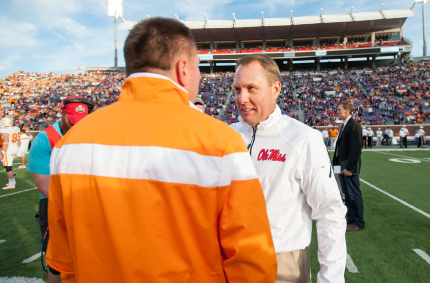 OXFORD, MS - OCTOBER 18: Head coach Hugh Freeze of the Mississippi Rebels talks with head coach Butch Jones of the Tennessee Volunteers prior to their game on October 18, 2014 at Vaught-Hemingway Stadium in Oxford, Mississippi. The Mississippi Rebels defeated the Tennessee Volunteers 34-3. (Photo by Michael Chang/Getty Images)