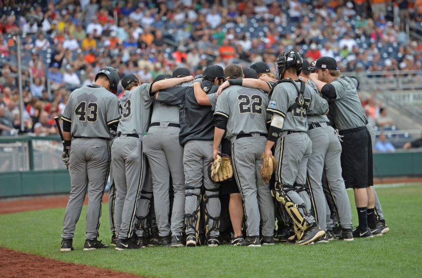 Omaha, NE - JUNE 23: Members of the Vanderbilt Commodores huddle up before the game against the Virginia Cavaliers during game two of the College World Series Championship Series on June 23, 2015 at TD Ameritrade Park in Omaha, Nebraska. (Photo by Peter Aiken/Getty Images)