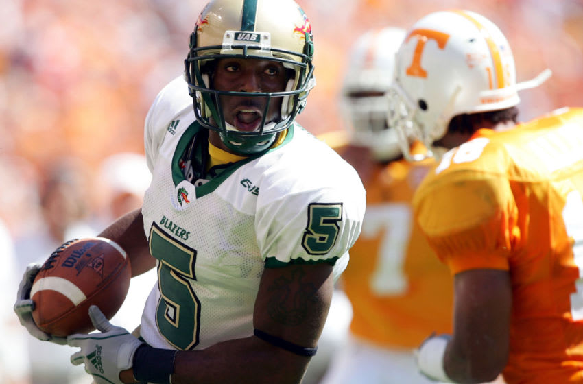 KNOXVILLE, TN - SEPTEMBER 3: Jhun Cook #5 of UAB carries the ball as Jason Allen #18 of Tennessee closes in on September 3, 2005 at Neyland Stadium in Knoxville, Tennessee. The Volunteers defeated UAB 17-10. (Photo by Elsa/Getty Images)