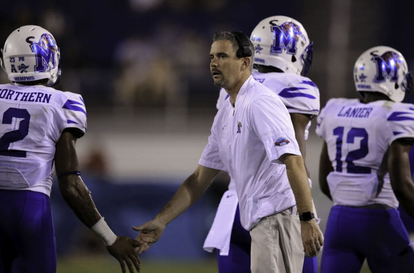 BOCA RATON, FL - DECEMBER 20: Head coach Mike Norvell of the Memphis Tigers slaps hands with players during the fourth quarter of the game against the Western Kentucky Hilltoppers at FAU Stadium on December 20, 2016 in Boca Raton, Florida. (Photo by Rob Foldy/Getty Images)