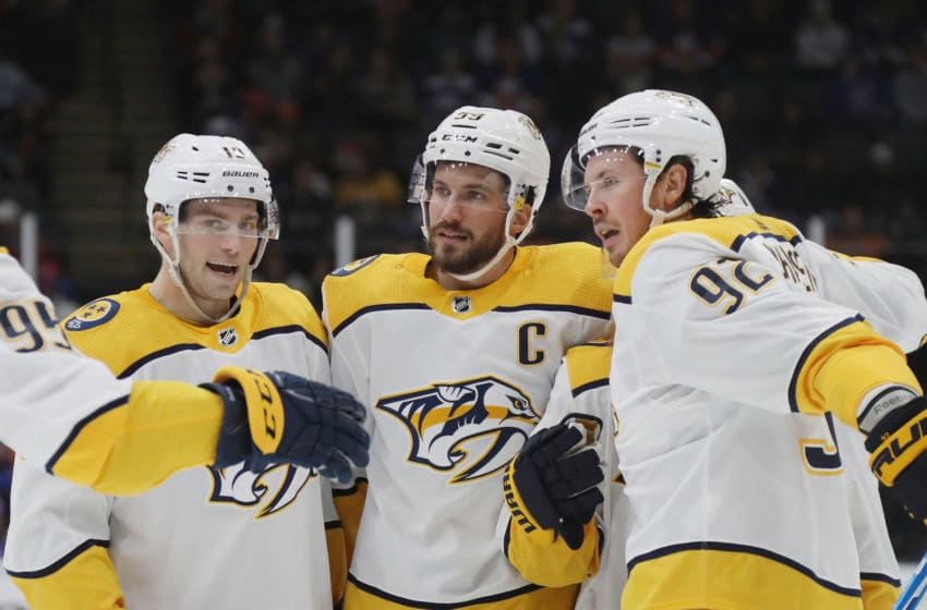 UNIONDALE, NEW YORK - DECEMBER 17: Roman Josi #59 of the Nashville Predators (C) celebrates his power-play at 11:36 of the third period against the New York Islanders at NYCB Live's Nassau Coliseum on December 17, 2019 in Uniondale, New York. The Predators defeated the Islanders 8-3. (Photo by Bruce Bennett/Getty Images)