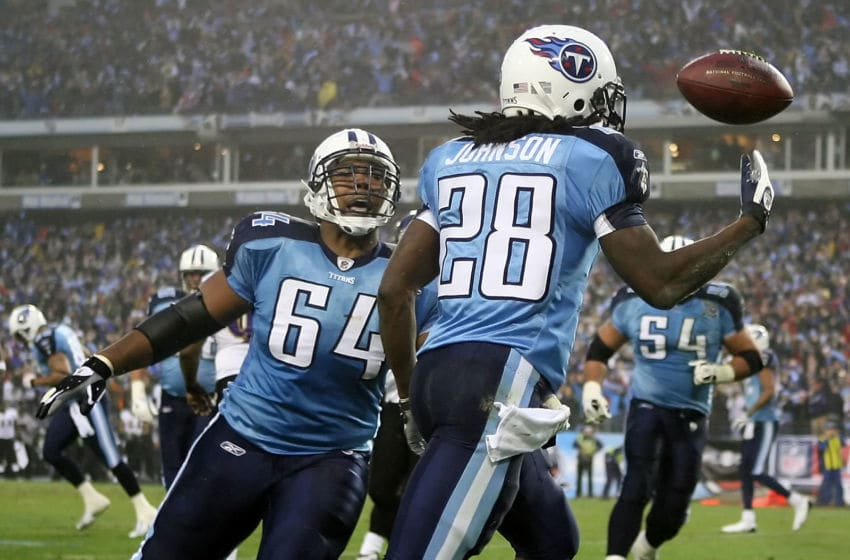 NASHVILLE, TN - JANUARY 10: Running back Chris Johnson #28 of the Tennessee Titans throws the ball up in the air and celebrates with teammate center Leroy Harris #64 after Johnson scored on an eight yard touchdown run in the first quarter against the Baltimore Ravens during the AFC Divisional Playoff Game on January 10, 2009 at LP Field in Nashville, Tennessee. (Photo by Andy Lyons/Getty Images)