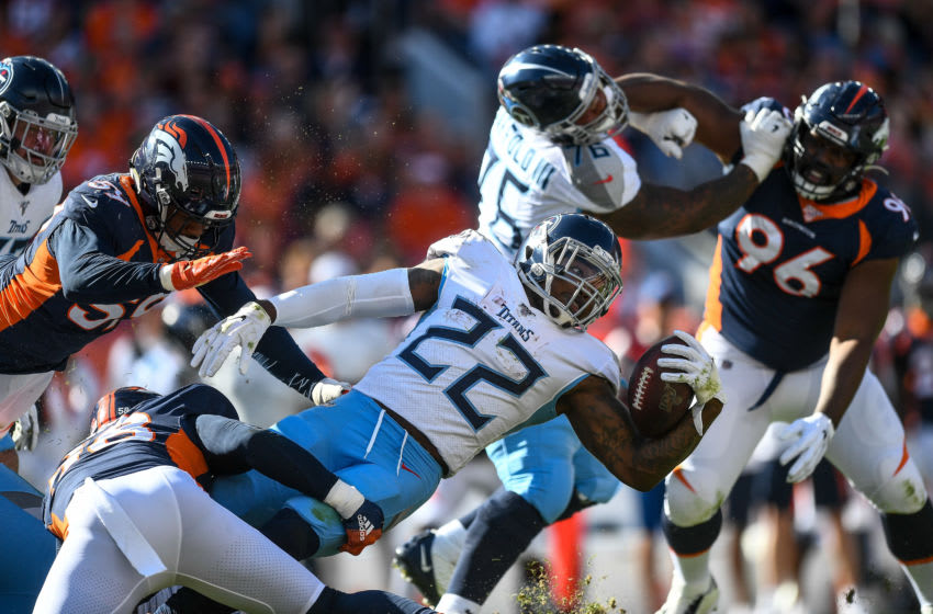 DENVER, CO - OCTOBER 13: Derrick Henry #22 of the Tennessee Titans is tackled by Von Miller #58 of the Denver Broncos in the second quarter of a game at Empower Field at Mile High on October 13, 2019 in Denver, Colorado. (Photo by Dustin Bradford/Getty Images)