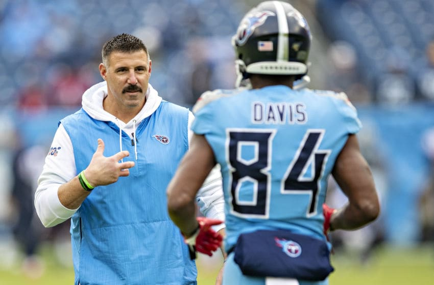 NASHVILLE, TN - DECEMBER 15: Head Coach Mike Vrabel talks with Corey Davis #84 of the Tennessee Titans on the field before a game against the Houston Texans at Nissan Stadium on December 15, 2019 in Nashville, Tennessee. The Texans defeated the Titans 24-21. (Photo by Wesley Hitt/Getty Images)