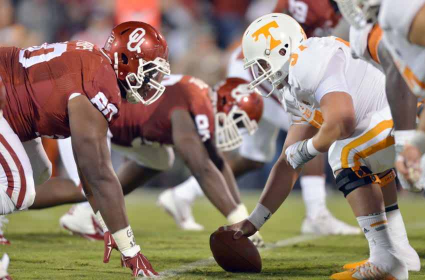 NORMAN, OK - SEPTEMBER 13: Defensive tackle Jordan Phillips #80 of the Oklahoma Sooners stares up at center Mack Crowder #57 of the Tennessee Volunters during first half action of their game on September 13, 2014 at Gaylord Family Memorial Stadium Norman, Oklahoma. (Photo by Jackson Laizure/Getty Images)