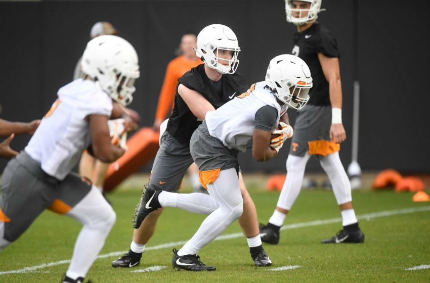 Tennessee quarterback Harrison Bailey (15) hands the ball off during Tennessee Vols football practice at University of Tennessee, Tuesday, March 10, 2020. Volfootball0310 0030