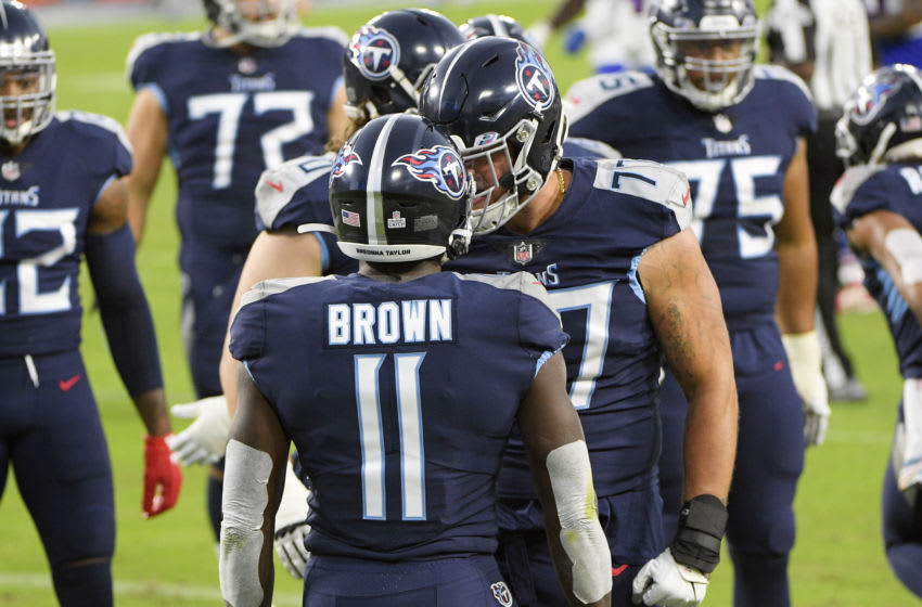 Oct 13, 2020; Nashville, Tennessee, USA; Tennessee Titans offensive tackle Taylor Lewan (77) celebrates the touchdown of wide receiver A.J. Brown (11) during the first half at Nissan Stadium. Mandatory Credit: Steve Roberts-USA TODAY Sports