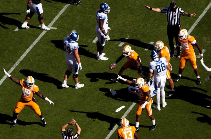 Tennessee defensive players signal a fumble as Tennessee defensive back Bryce Thompson (0) comes out of the pile with the ball during a SEC conference football game between the Tennessee Volunteers and the Kentucky Wildcats held at Neyland Stadium in Knoxville, Tenn., on Saturday, October 17, 2020. Kns Ut Football Kentucky Bp
