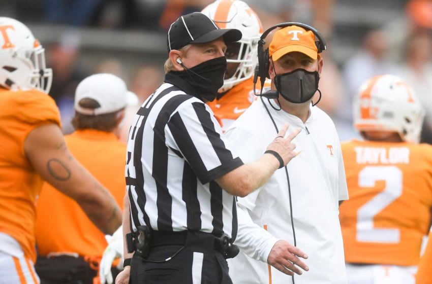 Tennessee Head Coach Jeremy Pruitt speaks with a game official during a game between Alabama and Tennessee at Neyland Stadium in Knoxville, Tenn. on Saturday, Oct. 24, 2020. 102420 Ut Bama Gameaction