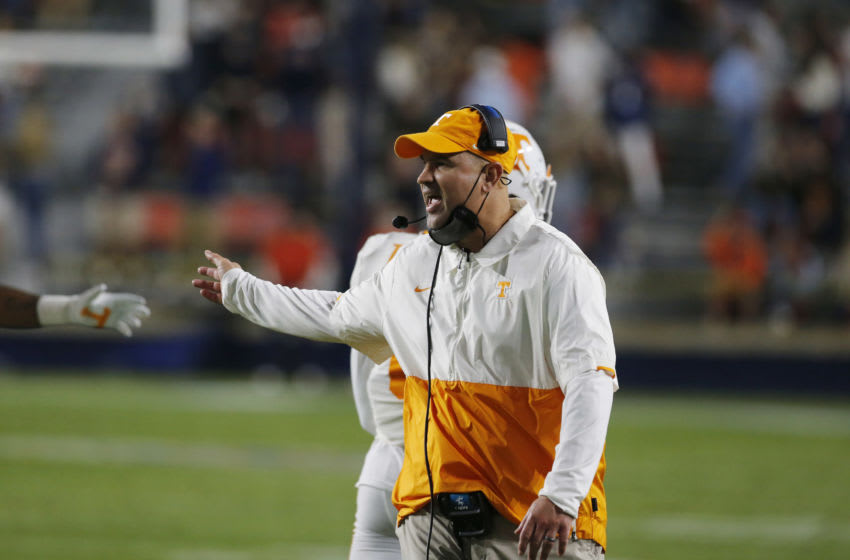 Nov 21, 2020; Auburn, Alabama, USA; Tennessee Volunteers head coach Jeremy Pruitt greets his team after a defensive stop against the Auburn Tigers during the first quarter at Jordan-Hare Stadium. Mandatory Credit: John Reed-USA TODAY Sports