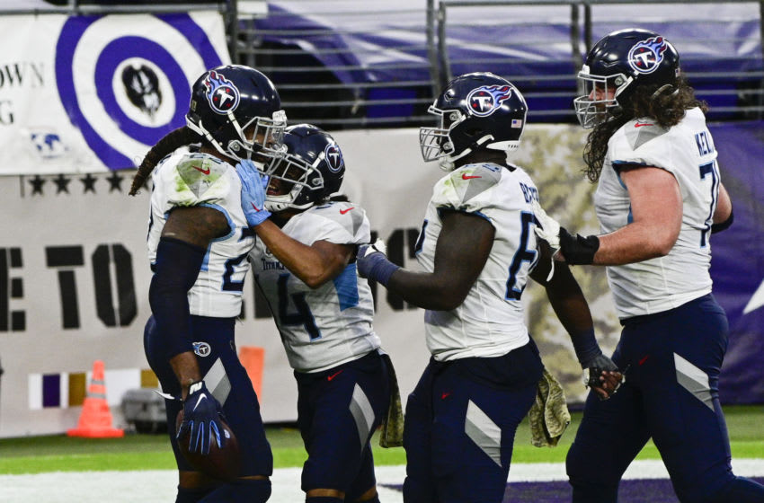 Nov 22, 2020; Baltimore, Maryland, USA; Tennessee Titans running back Derrick Henry (22) celebrates with teammates after scoring the game winning touchdown in overtime against the Baltimore Ravens at M&T Bank Stadium. Mandatory Credit: Tommy Gilligan-USA TODAY Sports