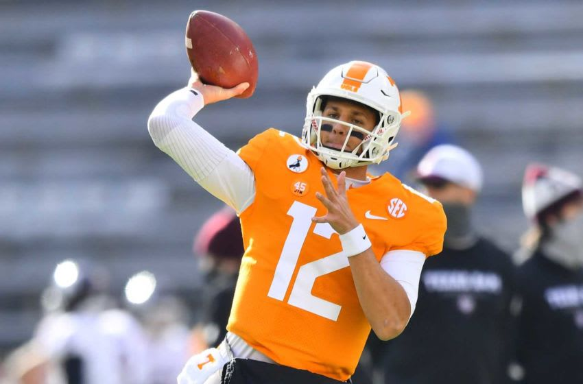 Tennessee quarterback J.T. Shrout (12) warms up before a game between Tennessee and Texas A&M in Neyland Stadium in Knoxville, Saturday, Dec. 19, 2020.