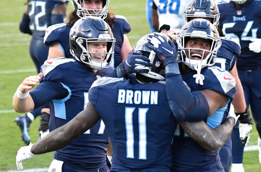 Tennessee Titans wide receiver A.J. Brown (11) celebrates his touchdown with quarterback Ryan Tannehill (17) and tight end Jonnu Smith (81) during the fourth quarter at Nissan Stadium Sunday, Dec. 20, 2020 in Nashville, Tenn. Aaa7755