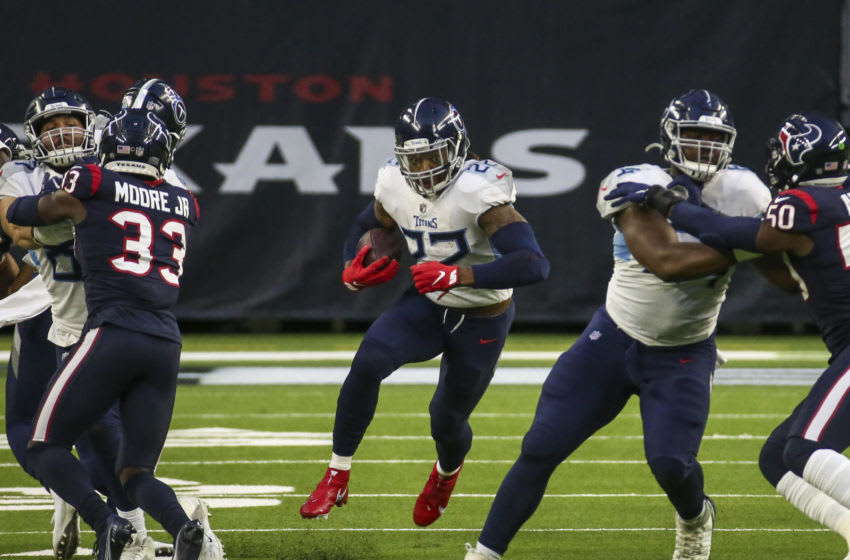 Jan 3, 2021; Houston, Texas, USA; Tennessee Titans running back Derrick Henry (22) runs with the ball during the third quarter against the Houston Texans at NRG Stadium. Mandatory Credit: Troy Taormina-USA TODAY Sports
