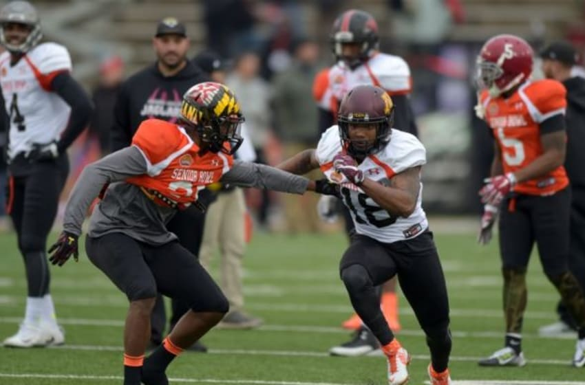 Jan 27, 2016; Mobile, AL, USA; South squad safety Sean Davis of Maryland (21) defends as South squad wide receiver K.J. Maye of Minnesota (18) tries to run a route in a drill during Senior Bowl practice at Ladd-Peebles Stadium. Mandatory Credit: Glenn Andrews-USA TODAY Sports