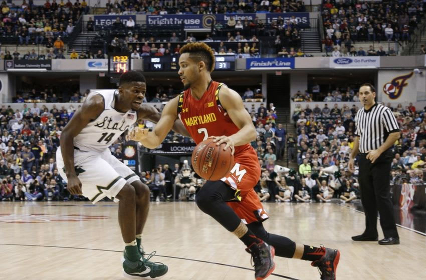 Mar 12, 2016; Indianapolis, IN, USA; Maryland Terrapins guard Melo Trimble (0) drives to the basket against Michigan State Spartans guard Eron Harris (14) during the Big Ten Conference tournament at Bankers Life Fieldhouse. Michigan State defeats Maryland 64-61. Mandatory Credit: Brian Spurlock-USA TODAY Sports