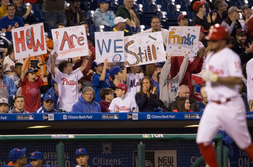 Apr 20, 2016; Philadelphia, PA, USA; Fans cheer as Philadelphia Phillies shortstop Freddy Galvis (13) funs past after hitting a two RBI home run during the second inning against the New York Mets at Citizens Bank Park. Mandatory Credit: Bill Streicher-USA TODAY Sports