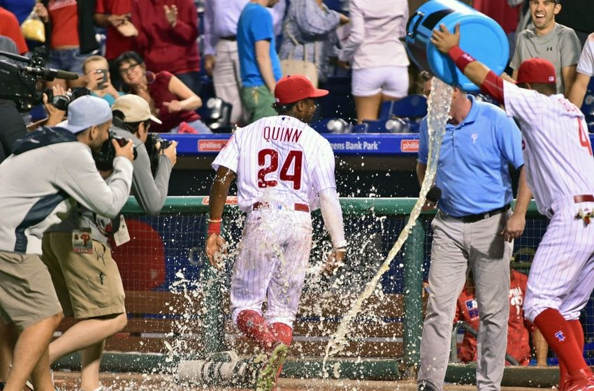 Sep 12, 2016; Philadelphia, PA, USA; Philadelphia Phillies right fielder Roman Quinn (24) reacts after having Powerade dumped on him during post game interview after win against the Pittsburgh Pirates at Citizens Bank Park. The Phillies defeated the Pirates, 6-2. Mandatory Credit: Eric Hartline-USA TODAY Sports