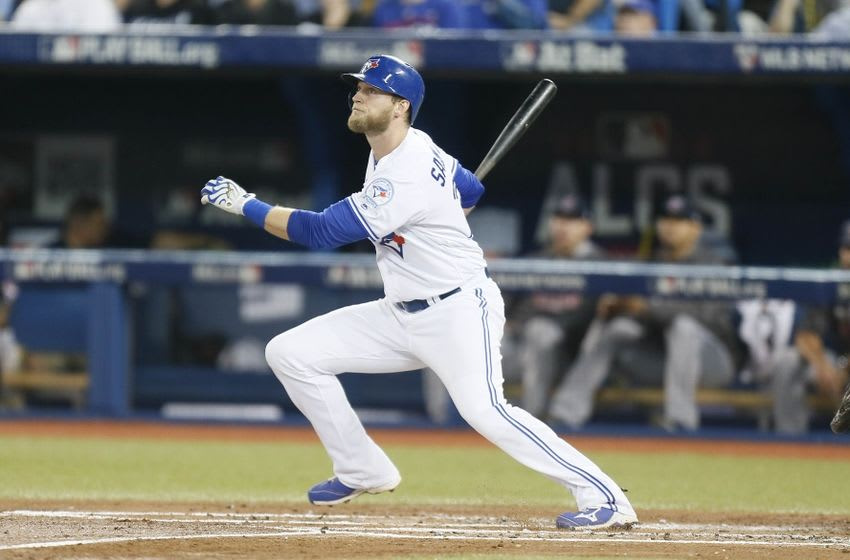 Oct 17, 2016; Toronto, Ontario, CAN; Toronto Blue Jays designated hitter Michael Saunders (21) hits a solo home run against the Cleveland Indians during the second inning in game three of the 2016 ALCS playoff baseball series at Rogers Centre. Mandatory Credit: John E. Sokolowski-USA TODAY Sports
